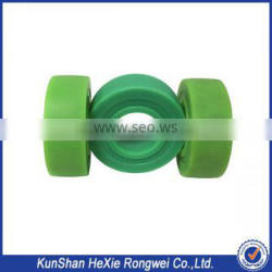 Green and white cnc precision machining parts