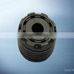 Sintered piston with groove